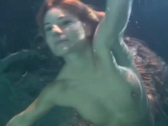 Redhead swimming in a dress is cute movies