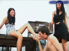 He gets trampled by two ladies in heels videos