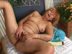 Old redhead guides toy into her hairy pussy videos