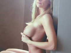 Fit body blonde with big tits teases solo videos