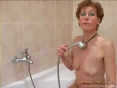 Mature strips from cardigan and shaves pussy videos