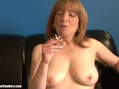 Mature blonde lady getting naked as she enjoys a smoke movies at find-best-lesbians.com