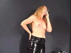 Perky titted blonde in leather pants enjoying a smoke movies at find-best-lingerie.com