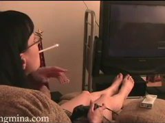 Mina plays a videogame and smokes videos