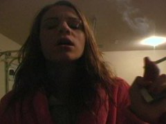 Teenager in bathrobe smokes sensually movies