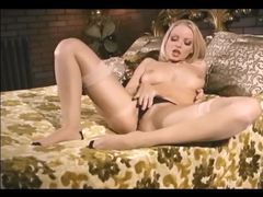 Sexy babe rubs her pussy in stockings and panties tubes