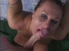 Horny milf stroking and sucking on a huge dong videos
