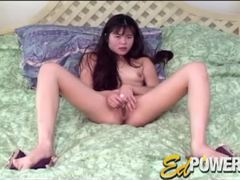 Cute masturbating asian girl with a vibrator tubes at korean.sgirls.net