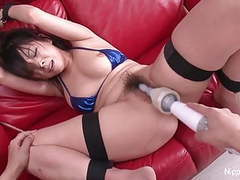 Young asian brunette is tied up and played with tubes at find-best-asian.com