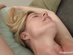 Blonde milf gets licked by her stepdaughter on the couch tubes