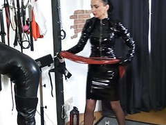 A vinyl domina whips her slave videos