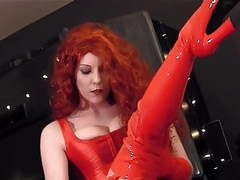 Redhead wearing red boots a corset and pantyhose videos