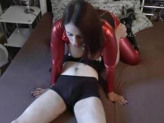 Slut in shiny red spandex cat suit fucks for condom cum movies