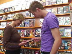 Sexy blonde mature fucks him in the video store movies