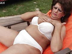 Hot grandma enjoys the pool and her hairy beaver movies at lingerie-mania.com