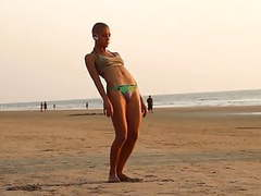 The bald yogi girl on the beach videos