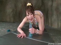 Japanese girl in bikini sits on toy videos