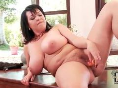 Chubby chick with a dildo has some fun videos
