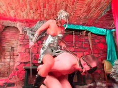 Chick in shiny metal outfit rides around a guy videos