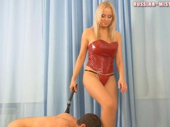 Mistress in red latex corset abuses him videos