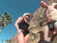 Dominatrix binds him to a rock in the hot sun videos