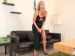 Beauty in evening gown chats and shows off toys clip