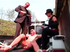 Guy bound in the back of a truck is abused videos