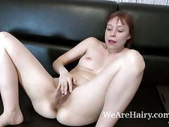 Trixie strips and masturbates on her black couch movies