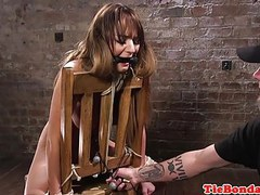 Whipped bdsm sub restrained for fingering tubes