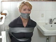 Blonde housewife in bathroom clip