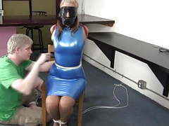 Secretary in a blue latex dress collared leashed and trained movies at freekiloclips.com