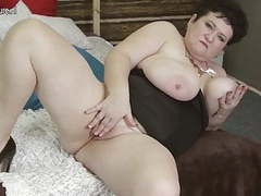 Big breasted mama playing with her old pussy movies