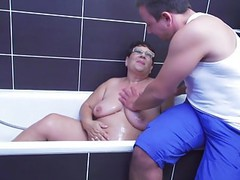 Big granny takes young cock after shower movies at kilosex.com