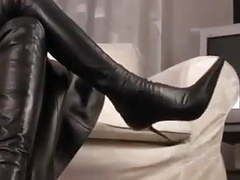 Hot brunette teasing in leather and high-heel boots tubes