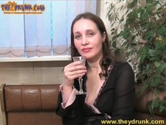 Cute girl in black dress strips and drinks clip