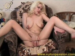 Blonde slowly teases in her sheer pantyhose videos