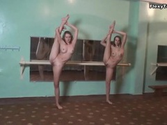 Two flexible ballerinas stretch in gym movies at sgirls.net