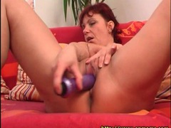 Mature redhead slides dildo into her cunt videos
