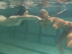 Underwater girls play with a hula hoop videos