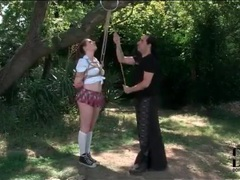 Schoolgirl in rope bondage suspension outdoors videos