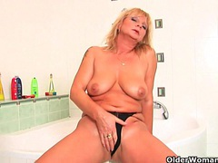 Big breasted granny gives her pussy a treat in the shower movies at lingerie-mania.com
