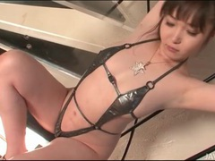 Shiny swimsuit is skimpy on japanese girl videos