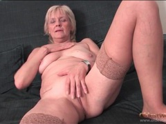 Granny strips to stockings and fingers pussy movies at kilosex.com