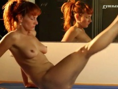 Flexible redhead bends naked body solo videos
