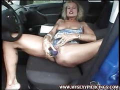 Milf with pierced pussy and nipples masturbating in the car movies at find-best-babes.com