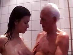 Old man and young girl showering together tubes