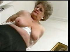 Chubby old granny strips and plays again tubes