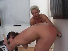 Muscular dyke fucks submissive chick with strap on during work out videos