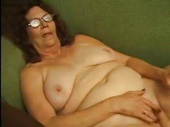 Granny in glasses strips and plays movies at find-best-hardcore.com