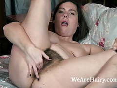 Sharlyn strips naked and masturbates in her bed tubes